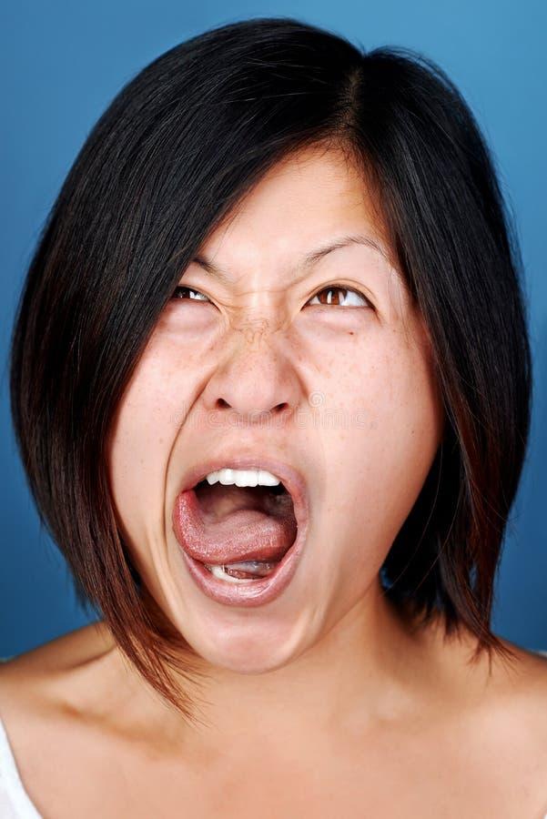 Muchacha divertida del chino de la cara fotografía de archivo