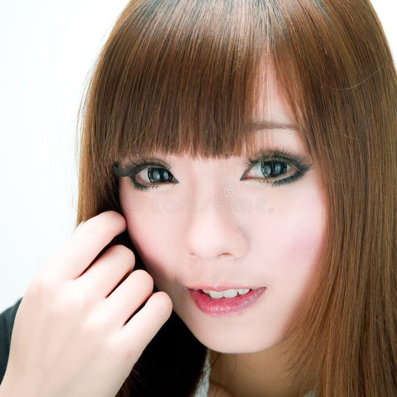 Muchacha dulce asiática de la sonrisa imagen de archivo