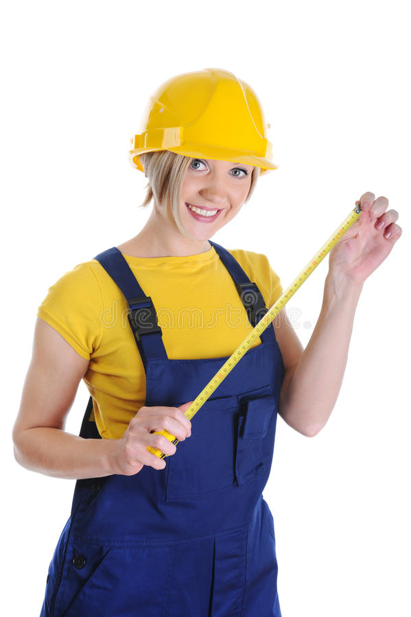 Muchacha el constructor en un casco amarillo imagen de archivo