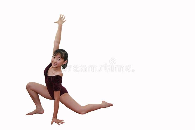 Muchacha en actitudes de la gimnasia imagen de archivo libre de regalías
