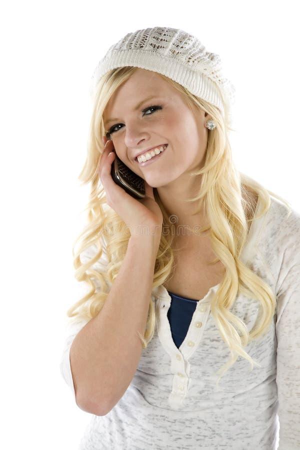 Muchacha en azul y blanco en el teléfono imagenes de archivo