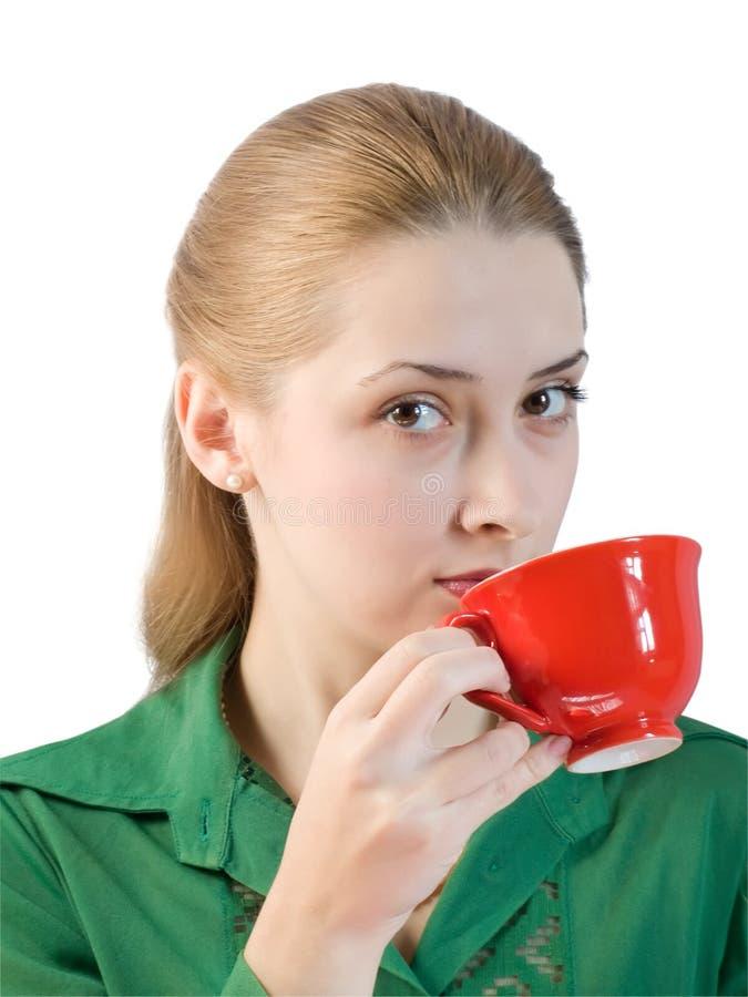 Muchacha en blusa verde con la taza de té imagen de archivo libre de regalías