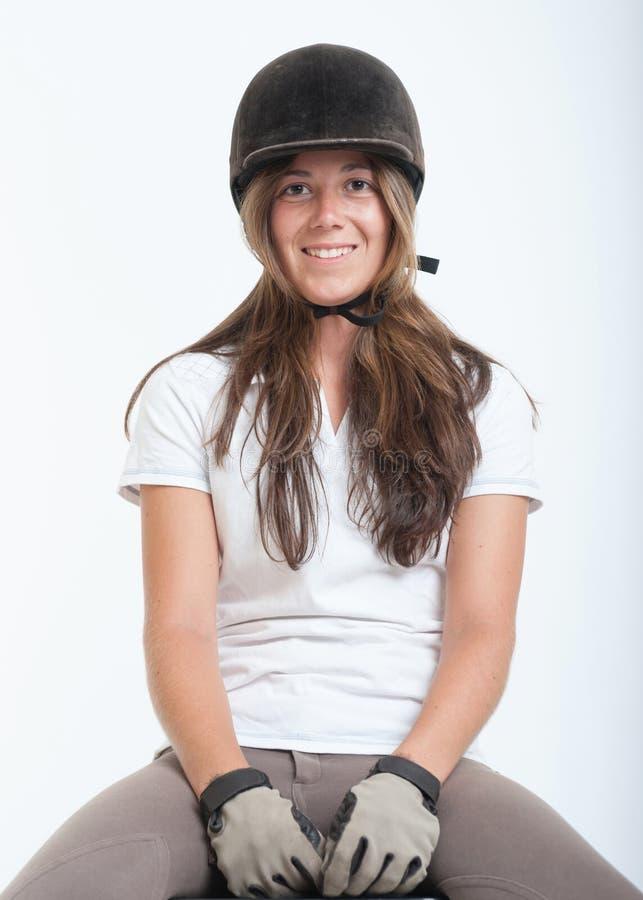 Muchacha en engranaje del montar a caballo foto de archivo libre de regalías