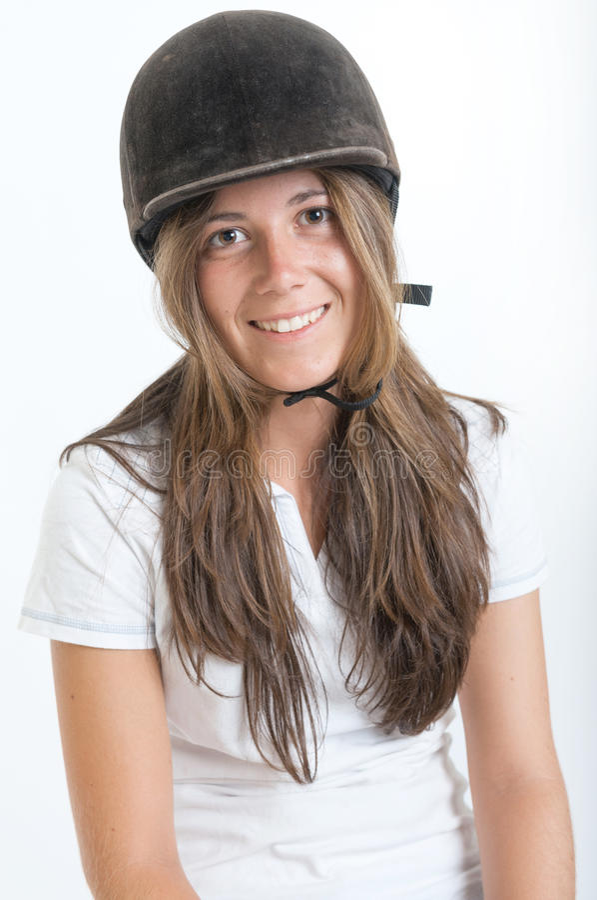 Muchacha en engranaje del montar a caballo fotografía de archivo