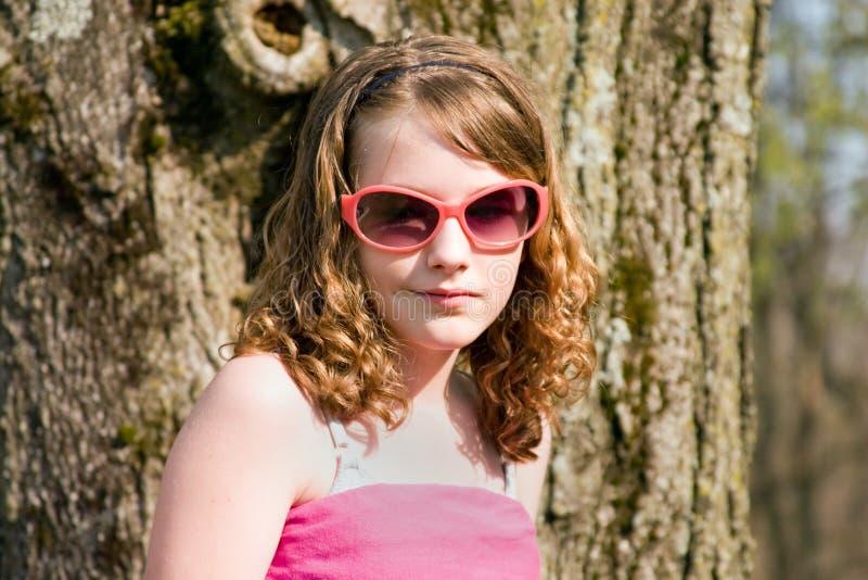 Muchacha en gafas de sol foto de archivo