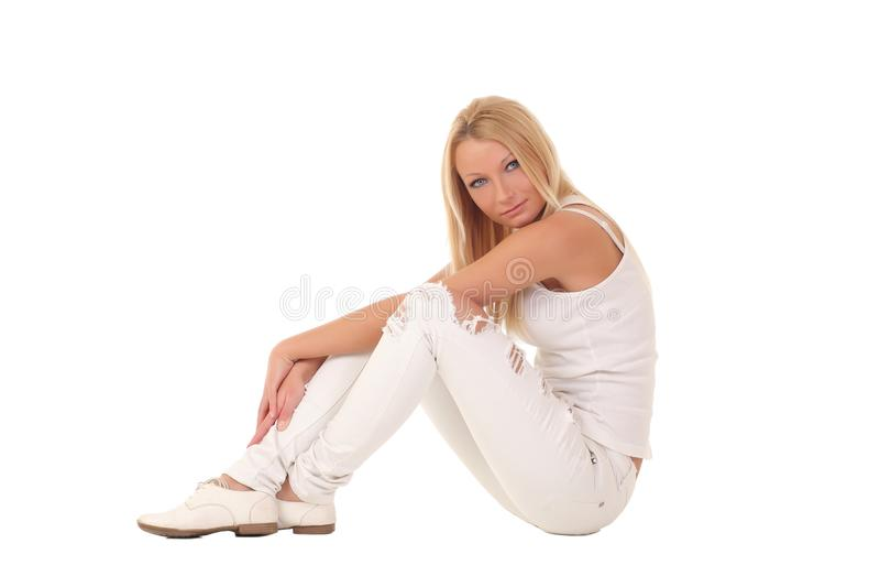 Muchacha en los pantalones blancos fotografía de archivo libre de regalías
