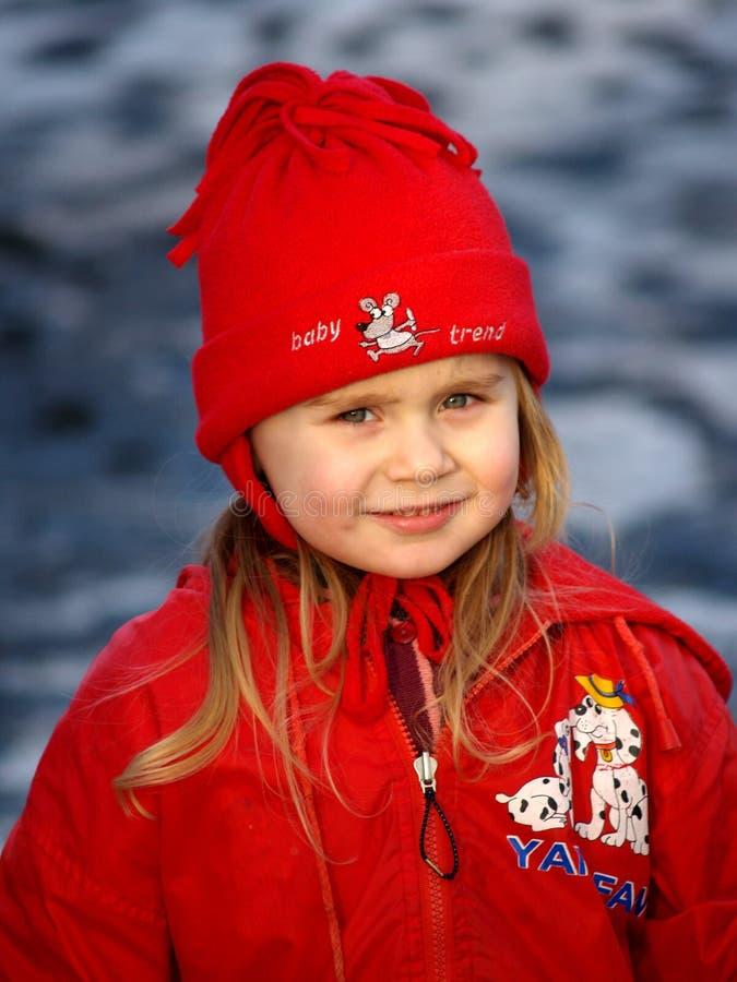 MUCHACHA EN RED HAT imágenes de archivo libres de regalías