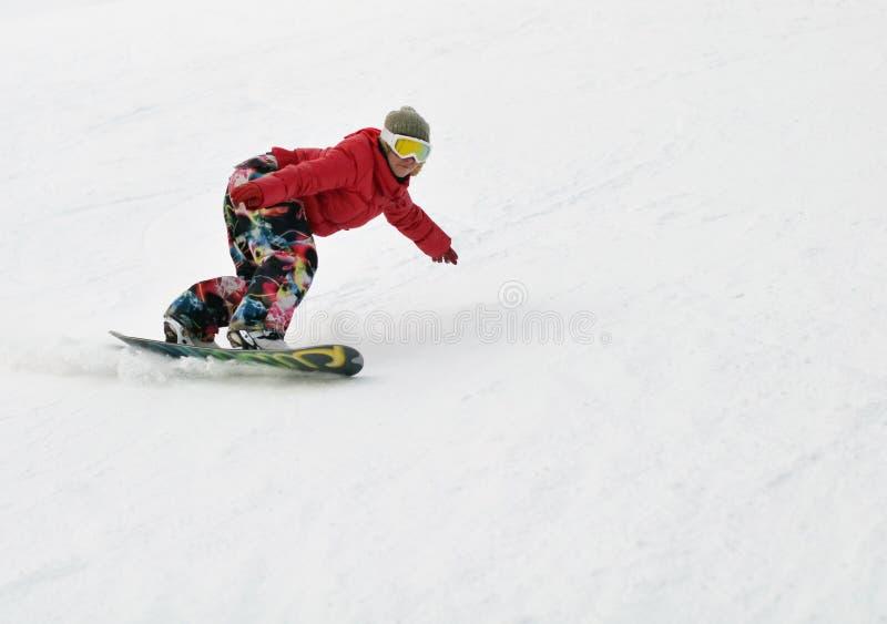 Muchacha en snowboard fotografía de archivo