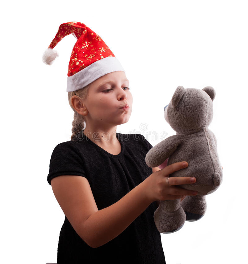 Muchacha en sombrero rojo de la Navidad foto de archivo