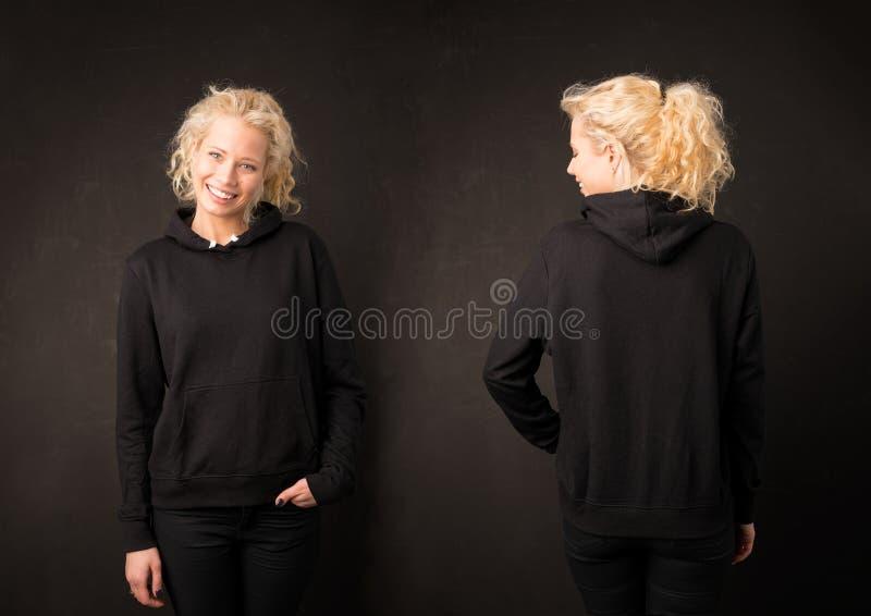 Muchacha en sudadera con capucha negra del frente y de la parte posterior imagen de archivo libre de regalías