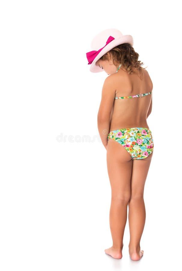 muchacha en un bañador y un sombrero fotos de archivo