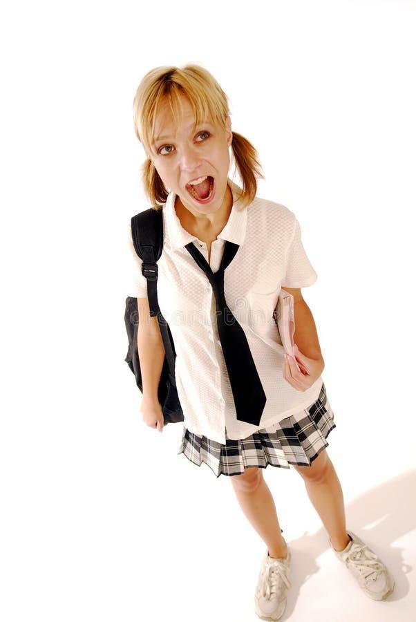 Muchacha en un uniforme escolar fotografía de archivo
