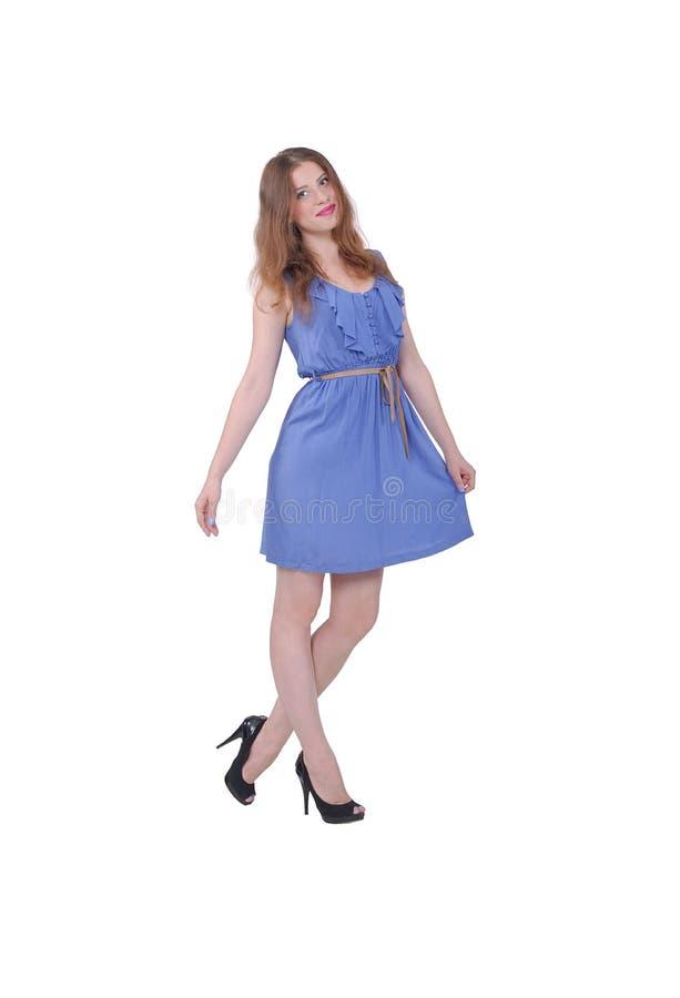 Muchacha en un vestido azul, verano imagenes de archivo