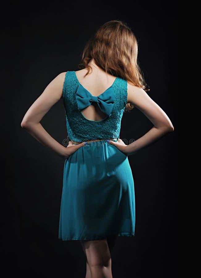 Muchacha en un vestido con un arco fotografía de archivo libre de regalías