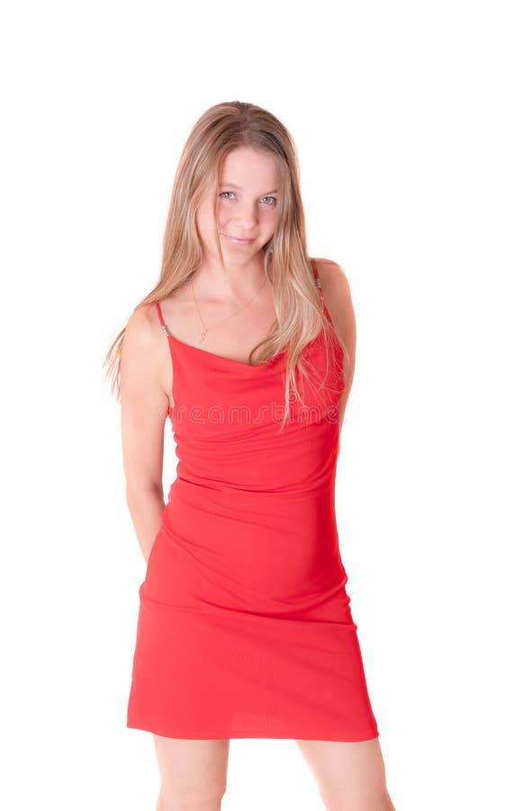 Muchacha en un vestido rojo imagenes de archivo