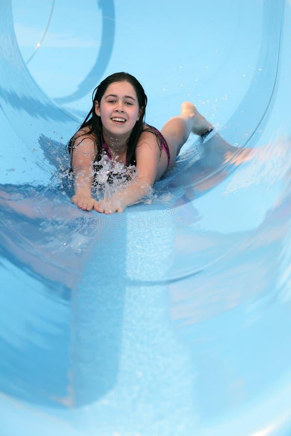 Muchacha en un waterslide fotografía de archivo libre de regalías