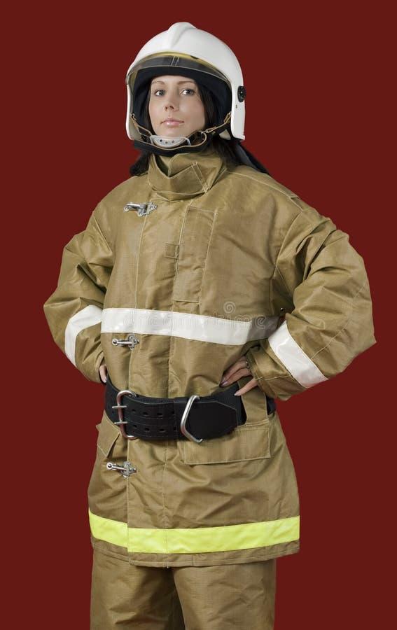 Muchacha en uniforme del bombero imagenes de archivo
