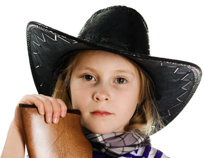 Muchacha en vaquero del sombrero negro imagen de archivo