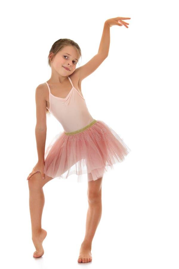 Muchacha en vestido rosado de los deportes fotos de archivo libres de regalías