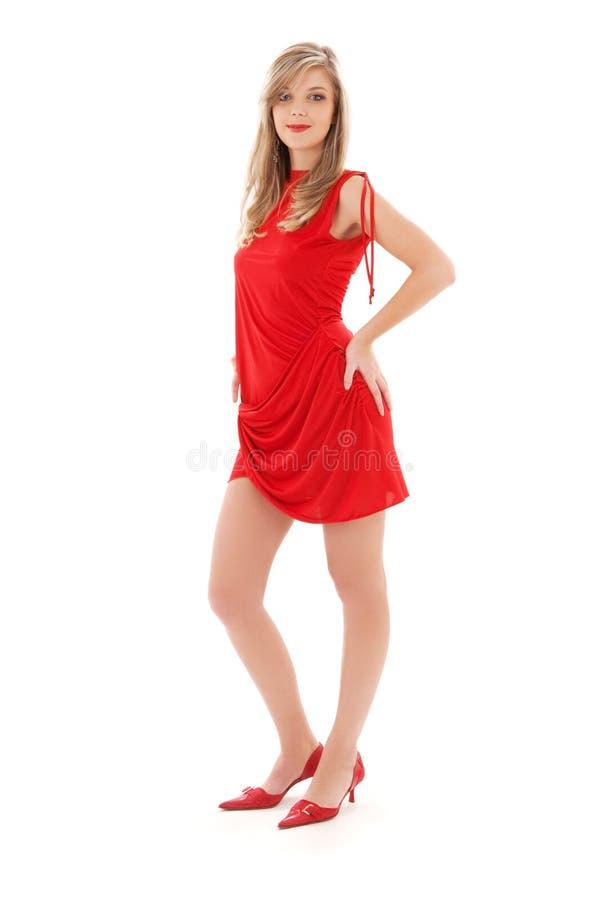 Muchacha encantadora en alineada roja imagenes de archivo
