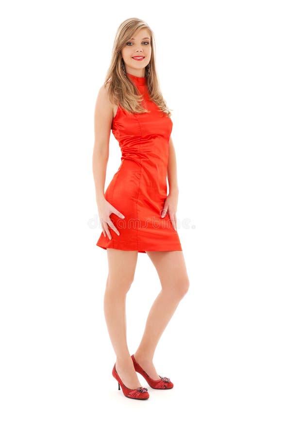 Muchacha encantadora en alineada roja imágenes de archivo libres de regalías