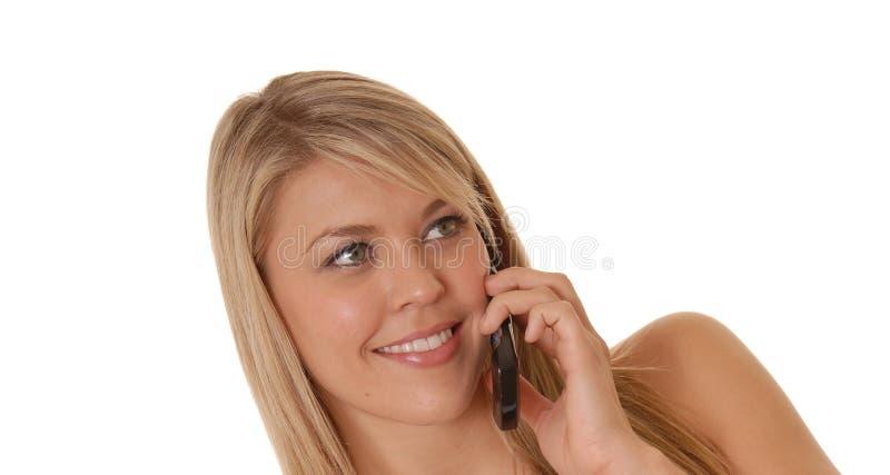 Muchacha encantadora en el teléfono celular fotografía de archivo libre de regalías