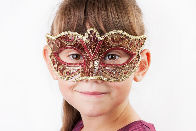 Muchacha encantadora en una máscara del carnaval imágenes de archivo libres de regalías