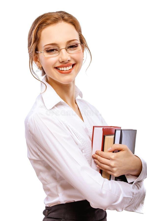Muchacha-estudiante sonriente con los libros de textos foto de archivo libre de regalías