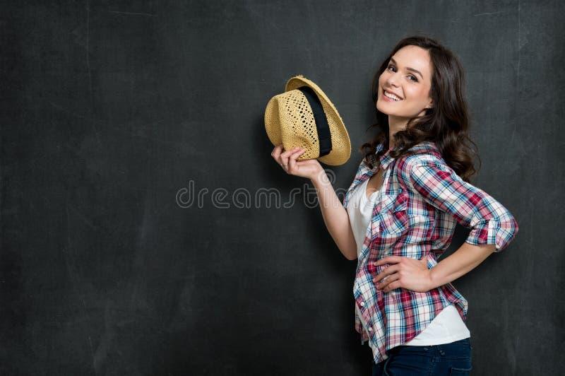 Muchacha feliz con el sombrero fotografía de archivo libre de regalías