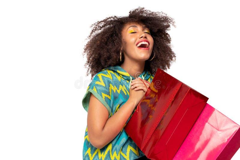 Muchacha feliz con los bolsos de compras imagenes de archivo