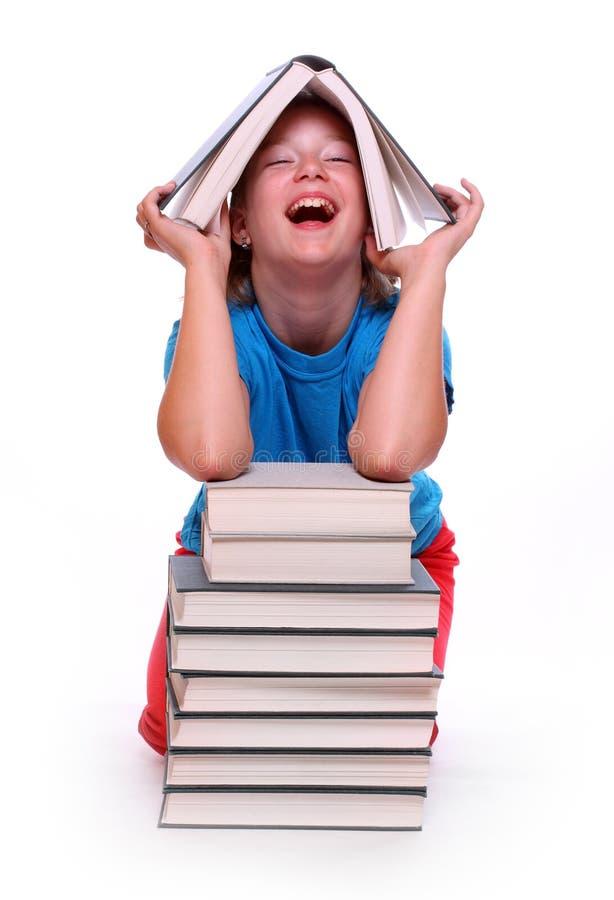 Muchacha feliz con los libros. imagen de archivo