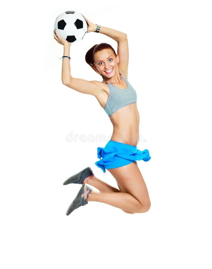 Muchacha feliz con una bola del balompié fotografía de archivo