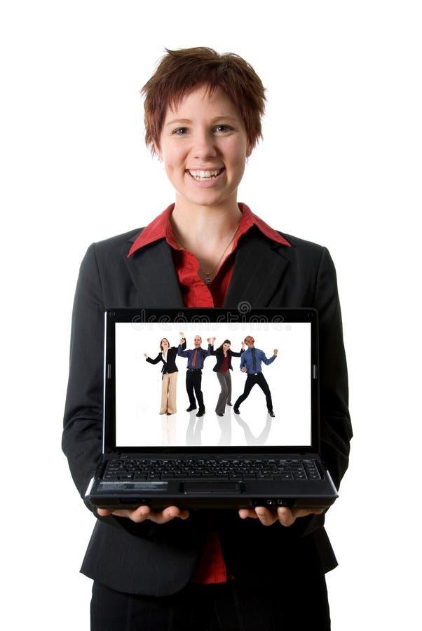 Muchacha feliz de la computadora portátil imagen de archivo
