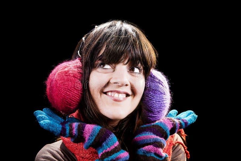 Muchacha feliz del invierno con las orejeras foto de archivo libre de regalías