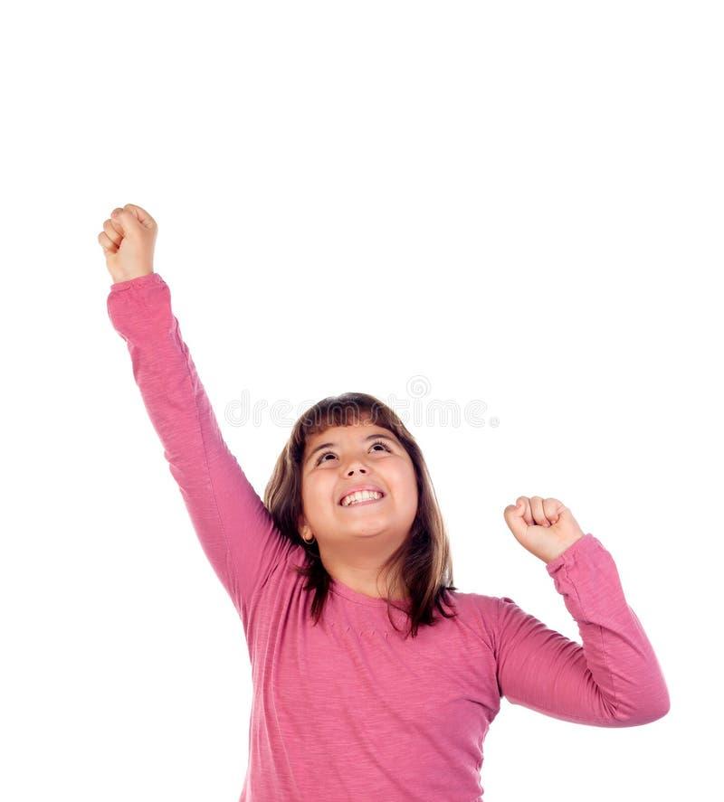 Muchacha feliz del niño con la camiseta rosada que estira sus brazos imagen de archivo libre de regalías
