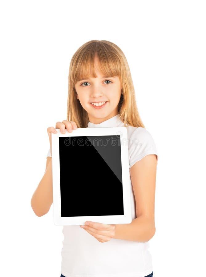 Muchacha feliz del niño con la tableta en blanco imagen de archivo libre de regalías