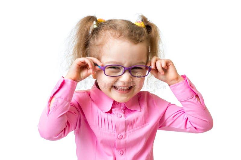 Muchacha feliz divertida en los vidrios aislados fotografía de archivo
