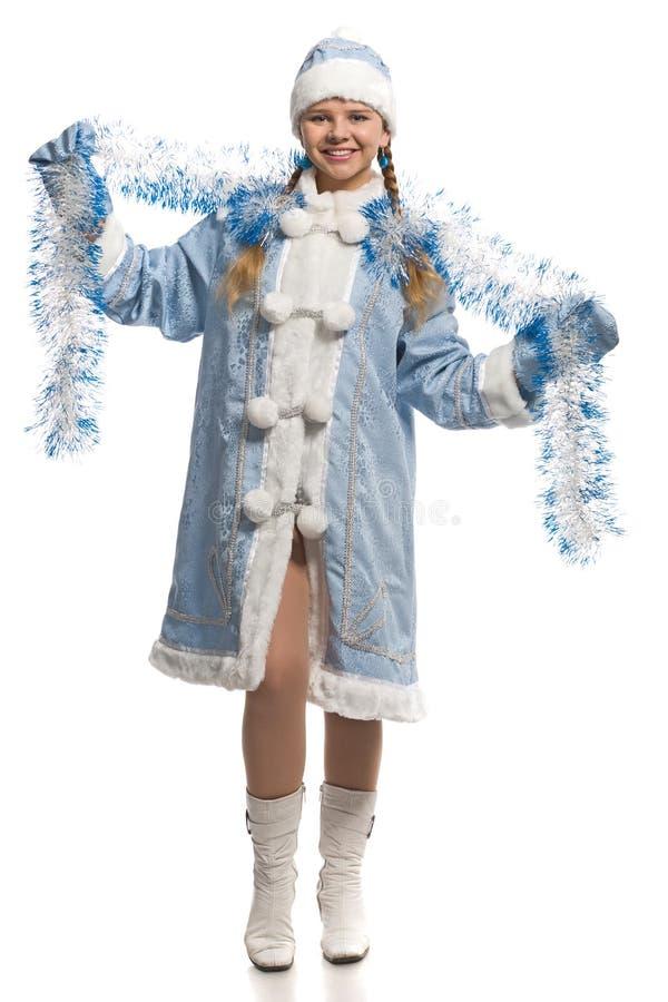 Muchacha feliz en traje virginal de la nieve con oropel fotos de archivo libres de regalías