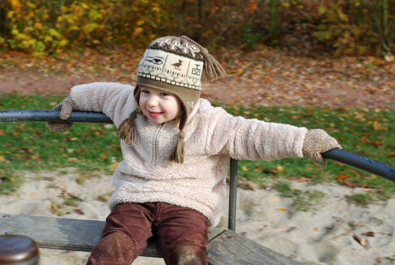 Muchacha feliz en un tiovivo fotografía de archivo libre de regalías