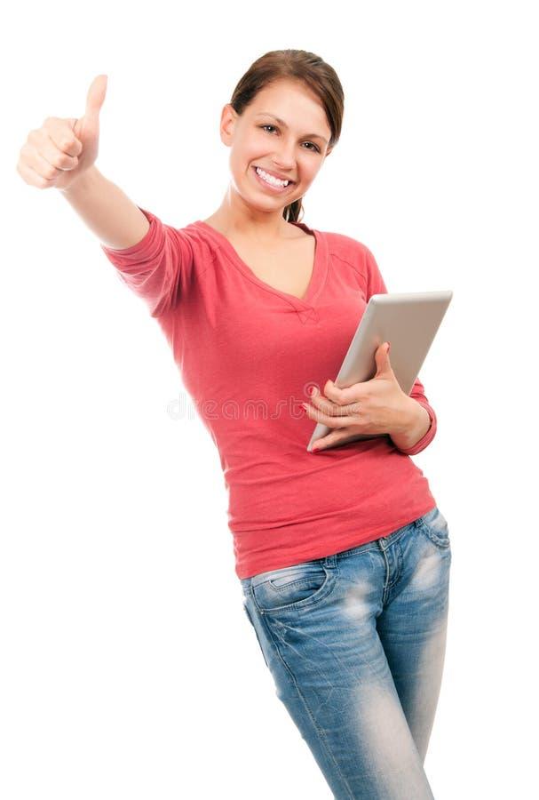Muchacha feliz joven del estudiante con PC de la tablilla imagen de archivo