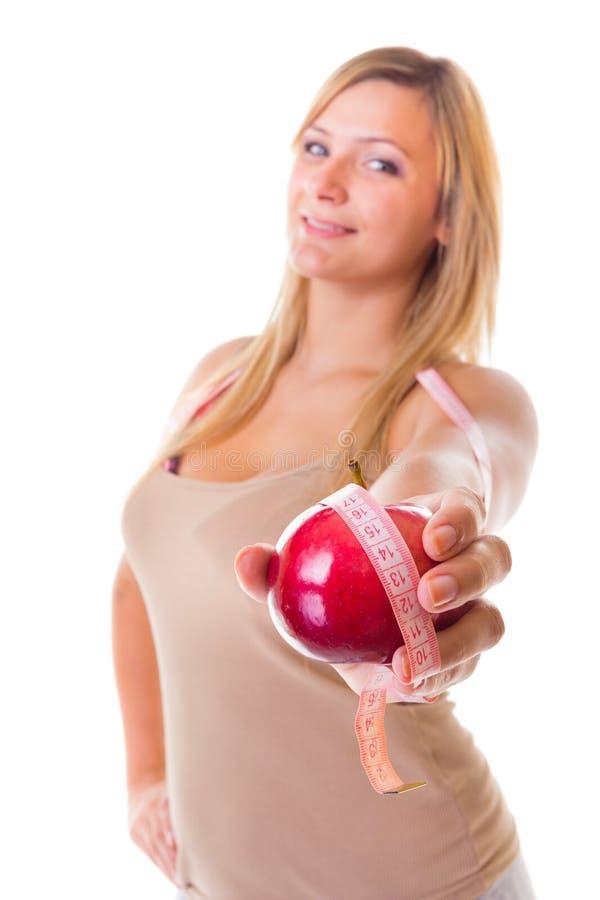 Muchacha grande del tamaño extra grande de la mujer con pérdida de peso de medición de la cinta de la manzana. Aislado. imágenes de archivo libres de regalías