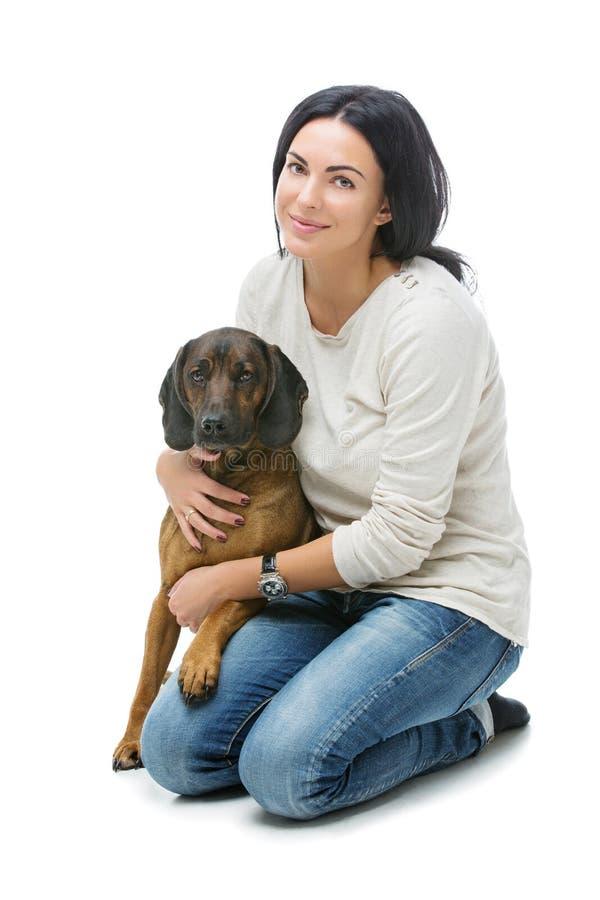 Muchacha hermosa con el perro fotos de archivo