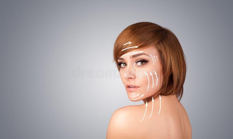 Muchacha hermosa con las flechas faciales en su piel imagen de archivo libre de regalías