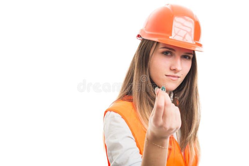 Muchacha hermosa del constructor que hace gesto del dinero imagenes de archivo