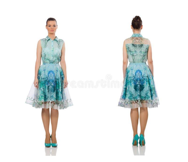 Muchacha hermosa en el vestido largo elegante aislado en blanco fotografía de archivo