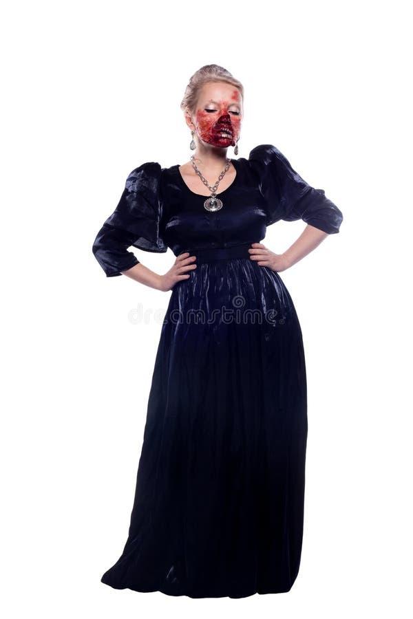 Muchacha hermosa en la imagen del zombi aislada en el backgro blanco fotografía de archivo