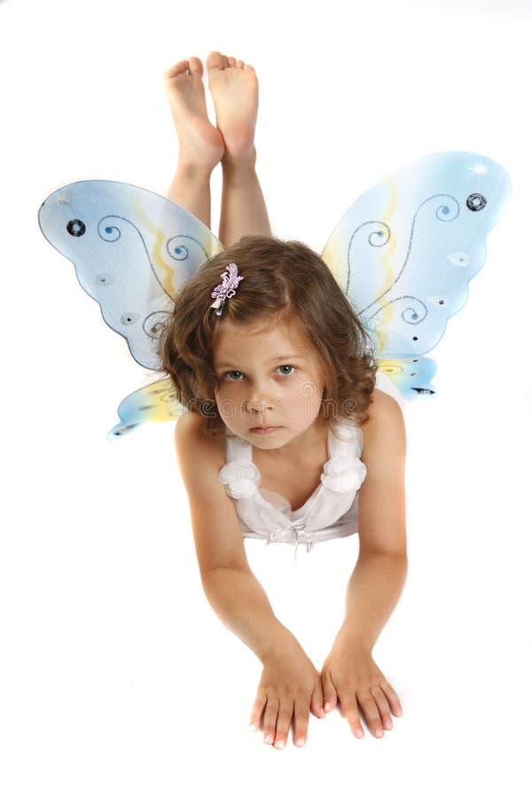 Muchacha hermosa en un traje de hadas con la mariposa w imagen de archivo