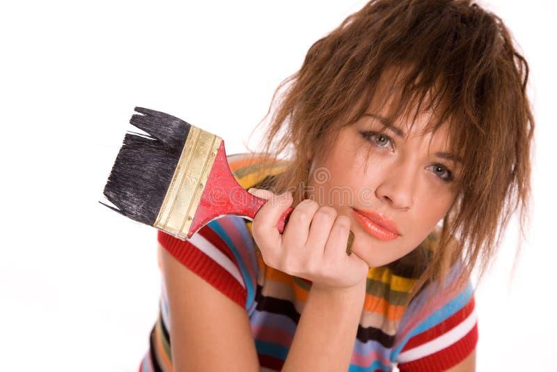 Muchacha hermosa joven con el cepillo de pintura imagen de archivo libre de regalías