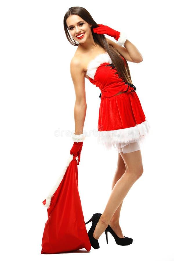 Muchacha hermosa que desgasta la ropa de Papá Noel foto de archivo libre de regalías