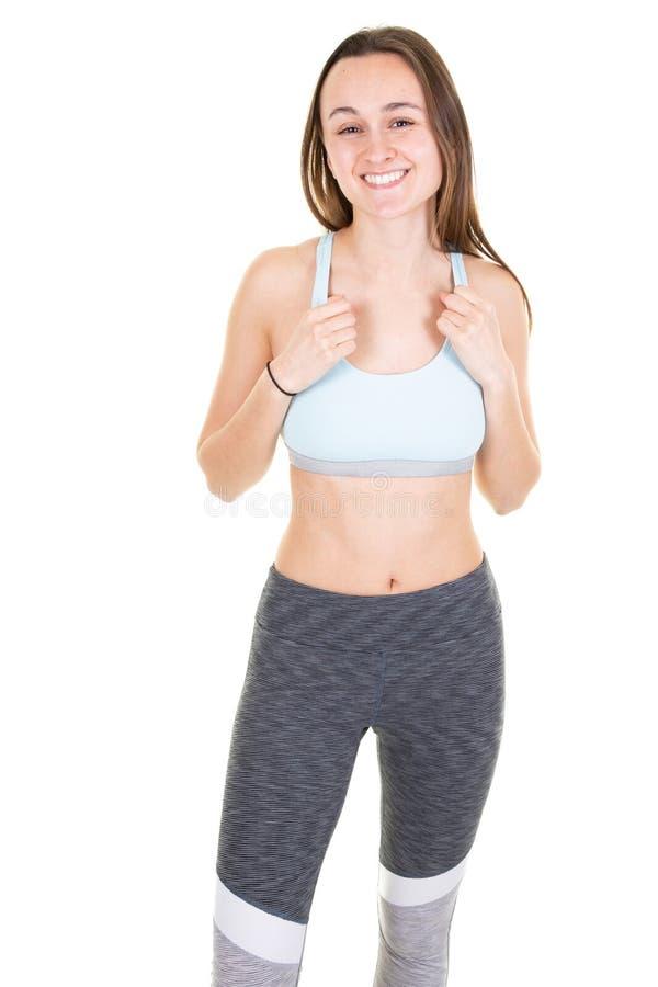 Muchacha hermosa que presenta en mujer joven sensual de la ropa del deporte con formas perfectas del cuerpo en actitud sana de la imagenes de archivo